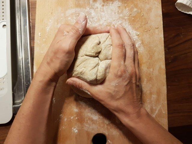 final folding of the dough as a hair bun