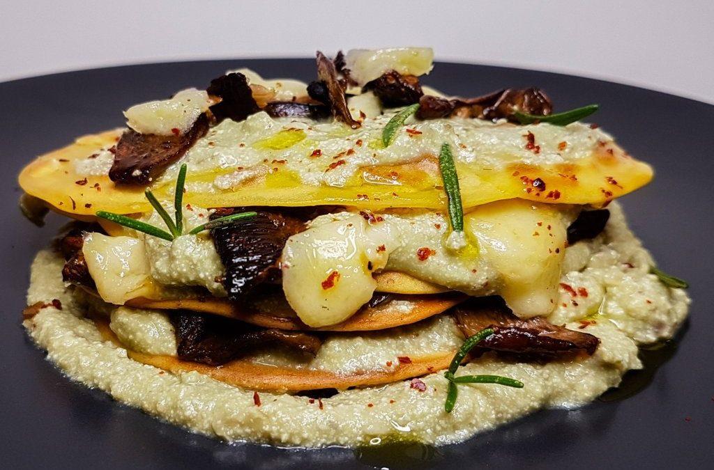 Mini chickpea crepes with avocado, leek, ricotta mousse and served with crispy portobello mushroom