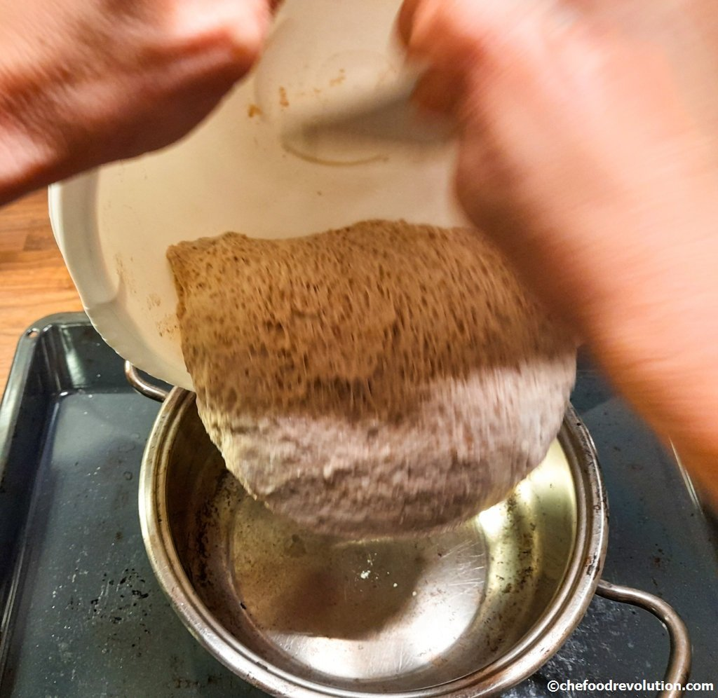 transfer of the whole wheat bread dough into the hot pot